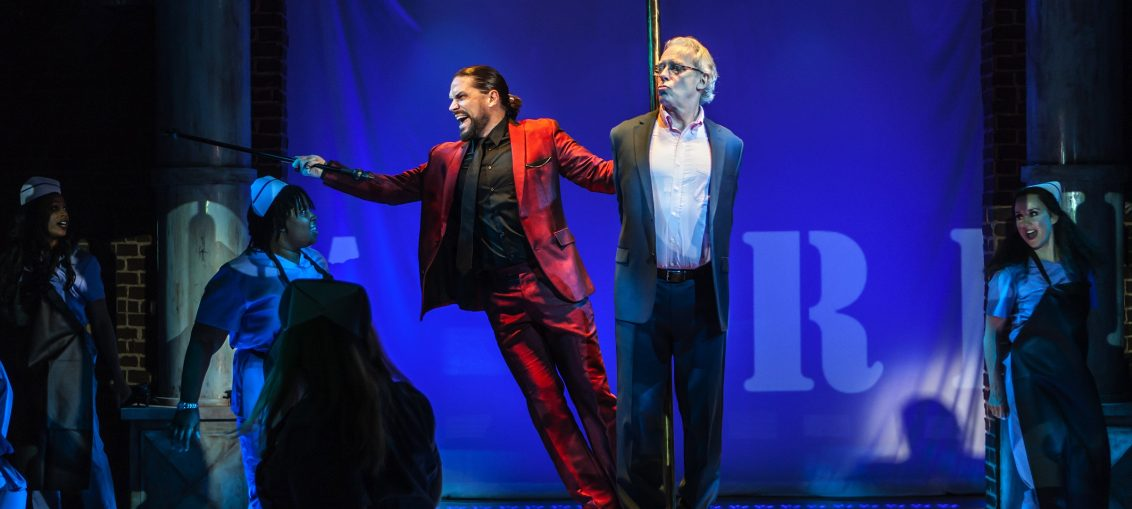 "L-R: Will Swenson, Terrence Mann in ""Jerry Springer – The Opera,"" a production from The New Group, in a limited Off-Broadway engagement at The Pershing Square Signature Center Jan 23 – Mar 11, 2018. PHOTO CREDIT: Monique Carboni / www.thenewgroup.org"